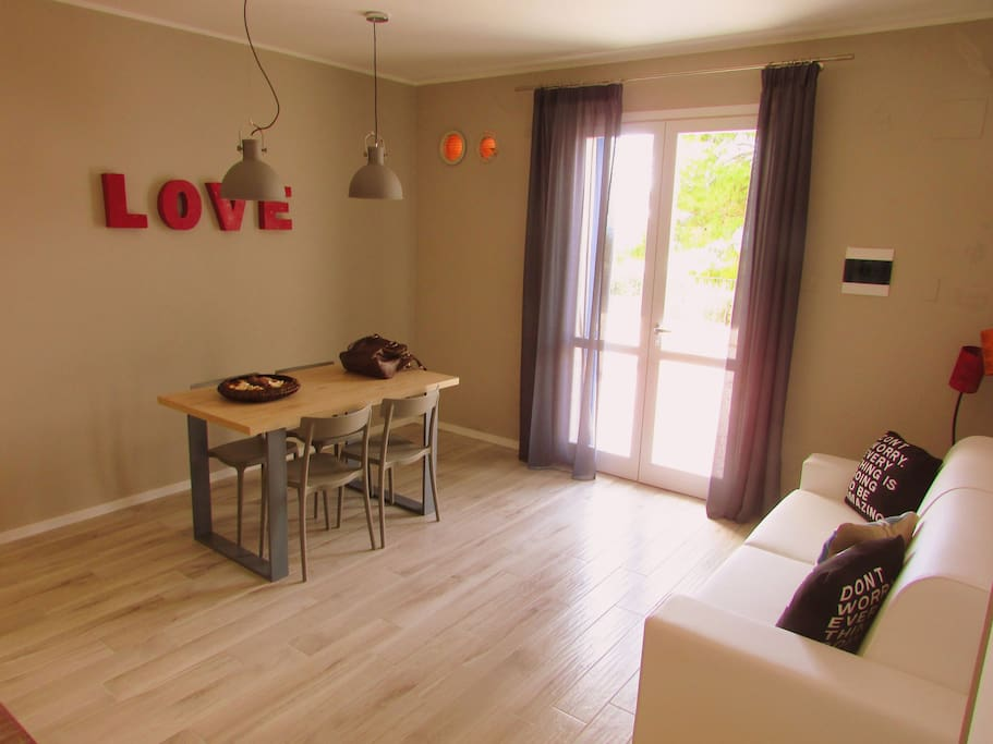 The living/kitchen with the double sofabed