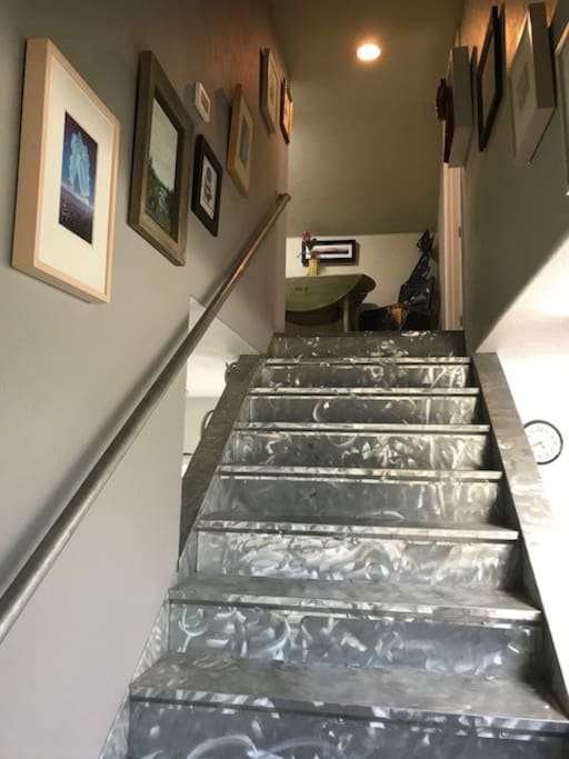 Artsy stairs to loft bedroom with lots of original art to look at, and meet the artist.