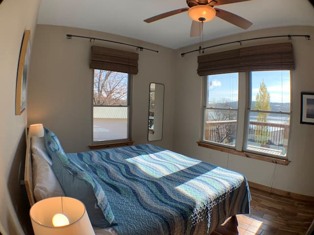 2nd guest room with king bed and lake views