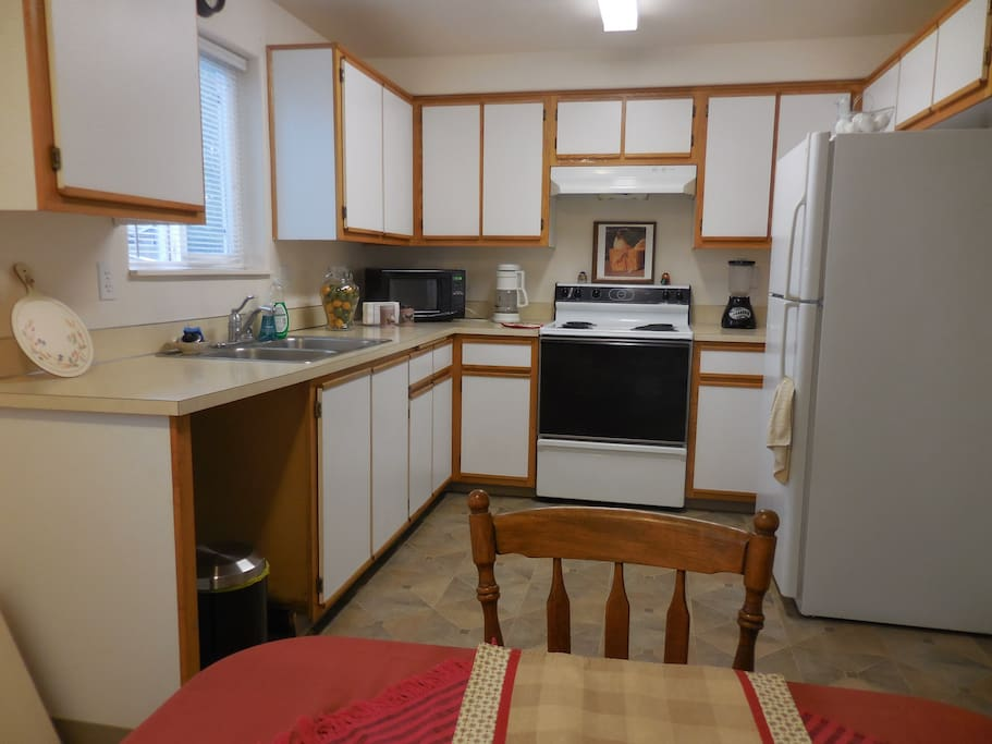 Kitchen is fully equipped and has all the essentials for your stay