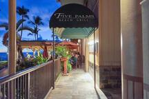 On-site beachfront restaurant with outdoor seating, bar, and great happy hour offerings.