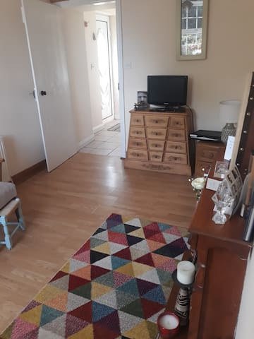 This is your small living room  where you can relax , have free WiFi  and English tv channels.  Very private with  added leaflets to nearby places of interest.
