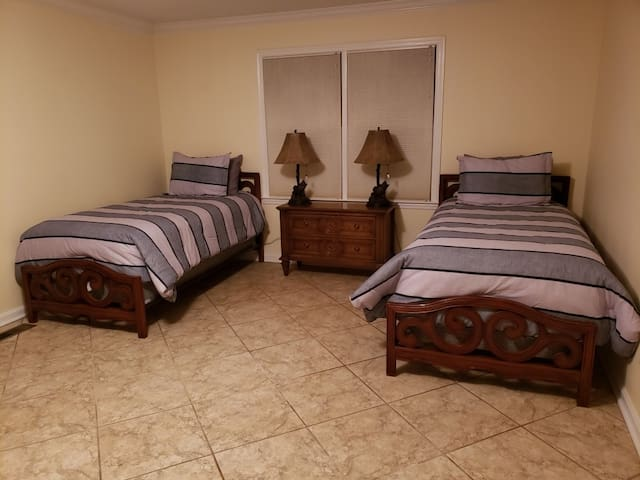 Spare room off kitchen set up with two twin beds for a 4th bedroom. Additional fold away cot beds and air mattress can be provided upon request when requesting 9 or more people for your stay.