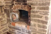 The old bread oven in the dis-used stone fireplace in the dining room.