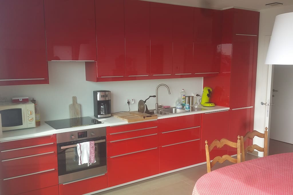 Large practical spacious kitchen with all modern amenities such as oven, microwave, refrigerator, freezer, dishwasher, coffee maker and Senseo