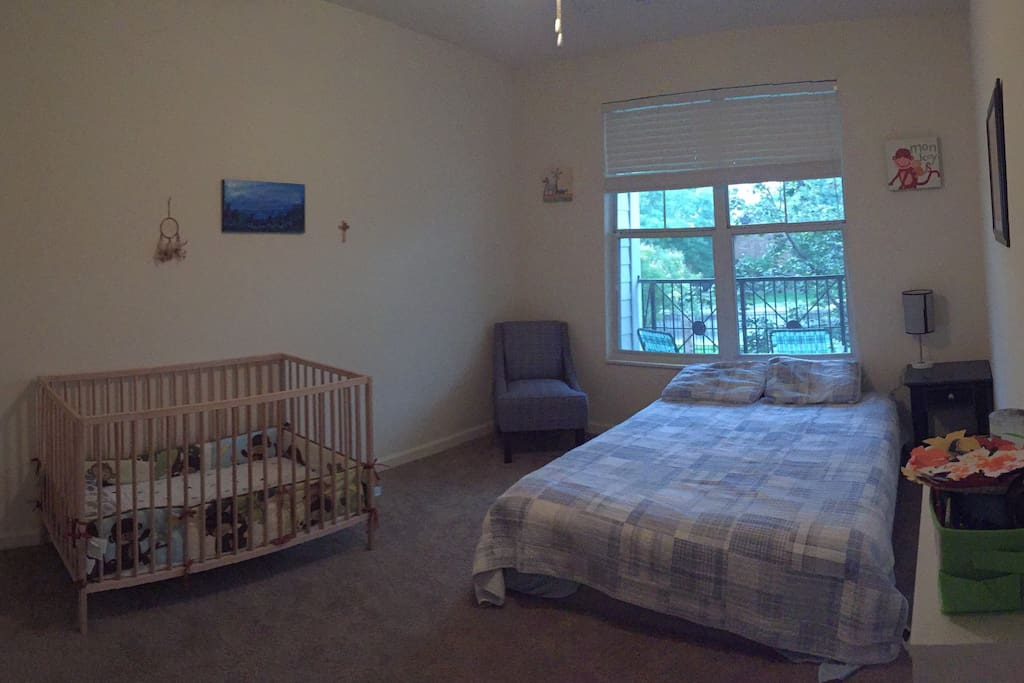 Second bedroom with queen size bed and crib