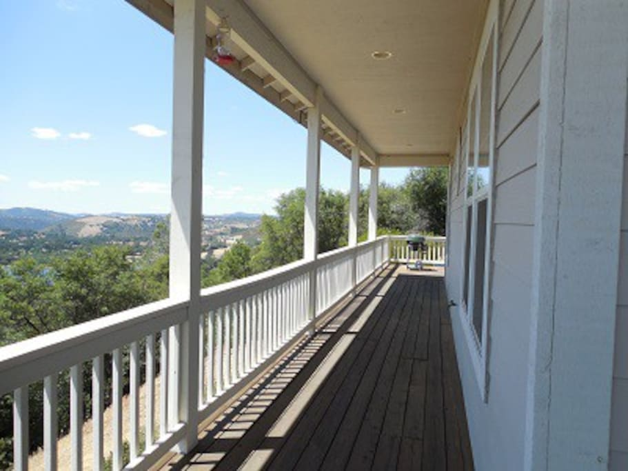 Wrap around porch with views of hills