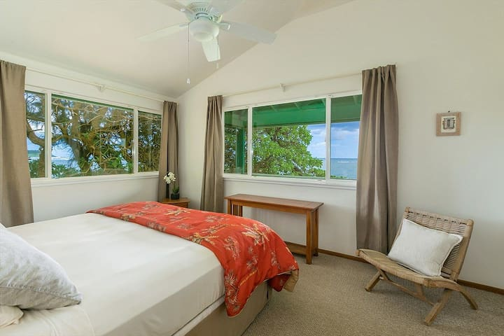 The master bedroom has a commanding view on both sides of the ocean and coral reef. Cool ocean breezes and the sound of waves gently lull you to a deep sleep.