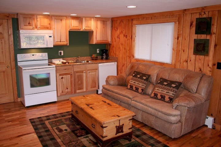 Relax next to fireplace in this Charming One Bedroom Chalet