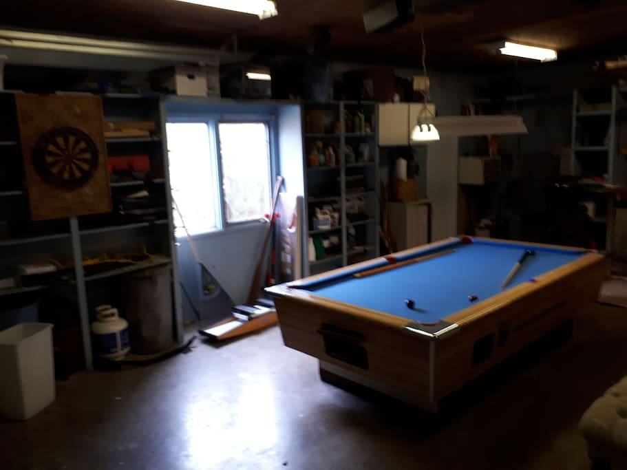garage cave  ... off the kitchen .. with pool table and dart board.