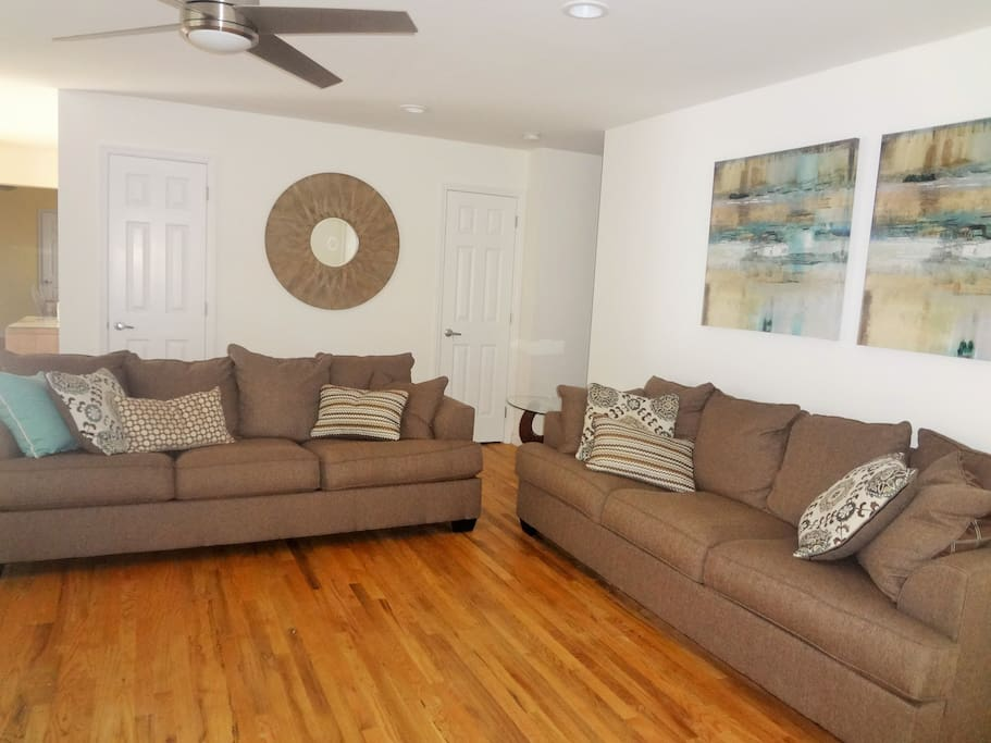 Living Room with lots of seating, sliders to pool, gas fireplace & large screen TV