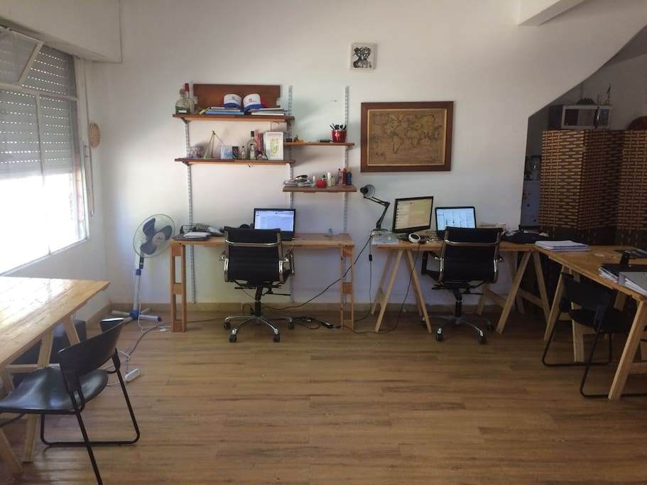 Cowork space. This area will be shared with us from 8am to 5pm, while we work. You are welcome to use it to, to do some work or even to receive someone in our meeting room.