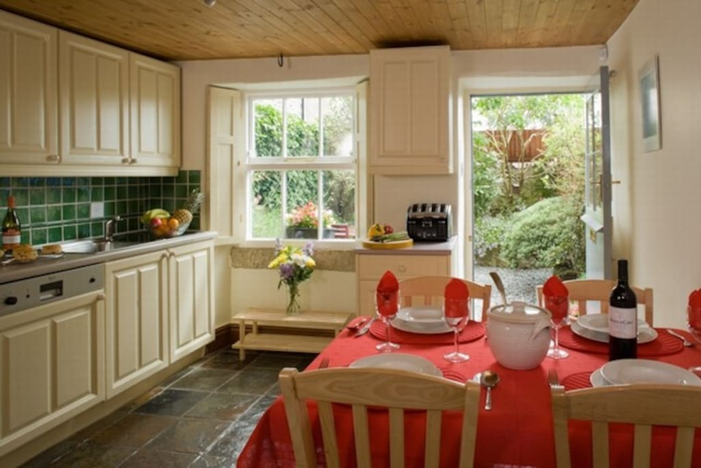 Well-equipped kitchen opening onto the patio-style garden