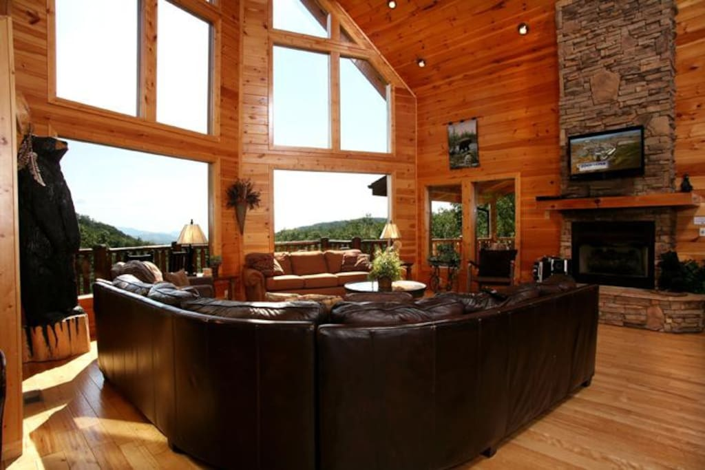 Simply stunning - As gorgeous as the great room is—stellar furnishings, burnished wood floors and walls, a stone-surround gas fir