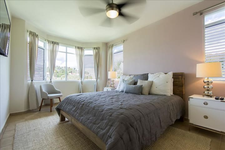 Master Bedroom has a king bed and reading chair