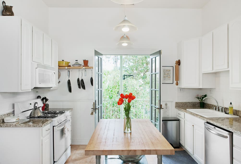 Kitchen doors open up onto sunny back porch