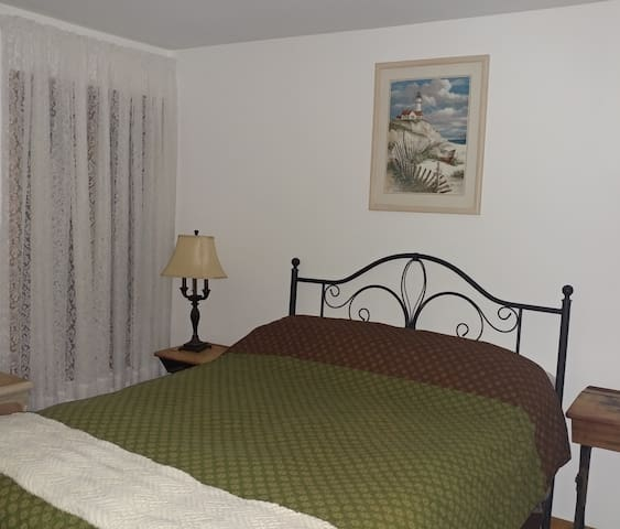 """This FIRST FLOOR GUEST ROOM is the one & only GUEST ROOM.  No basement """"sleeps"""" here.  The large GUEST BATHROOM with SHOWER is directly across the hallway to ensure privacy during the stay.  NOTE: There is an abundance of daylight in this room."""