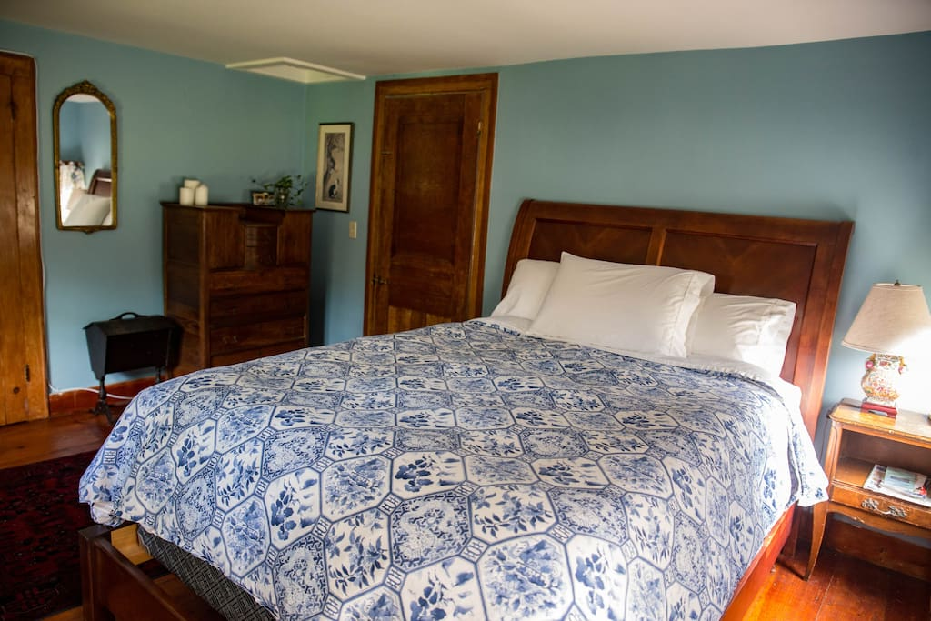 UPSTAIRS BEDROOM #1: An innerspring queen mattress offers a firm night sleep with a down feather comforter and quality linens.