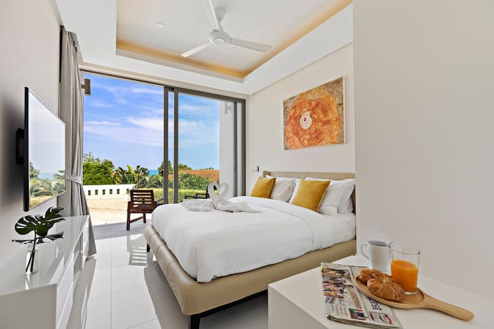 Bedroom 4 with balcony and some sea views