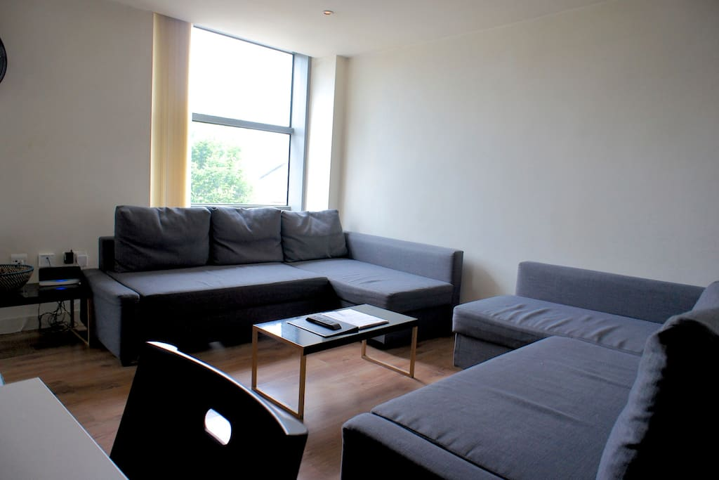 Here's your living room with balcony and two double sofa beds