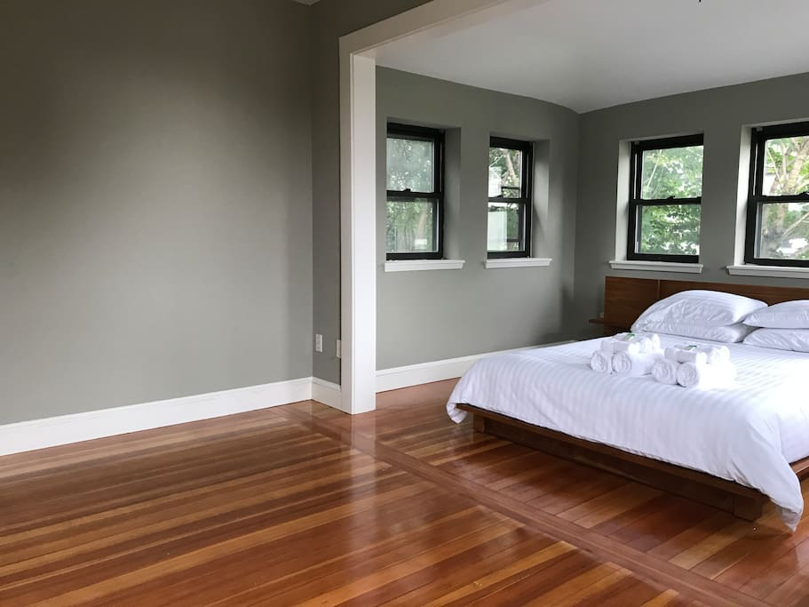 Huge fabulous sun-lit bedroom with new wood floors, new CB2 Andes Acacia bed, plus clean fresh cotton linens, towels and toiletries upon arrival.