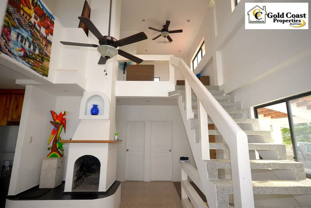 Beautiful entrance to the home with the stairs to the master bedroom leading upstairs