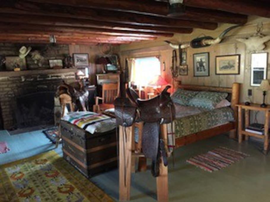 The historic cabin has a queen bed plus a bonus twin.