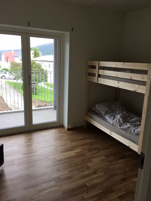 Bunkbed and wardrobe in the largest bedroom