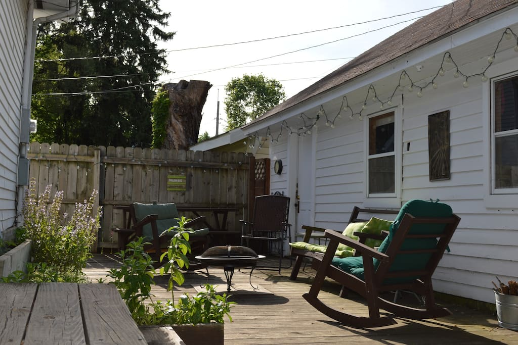 Back yard patio with separate entrance into back suite.