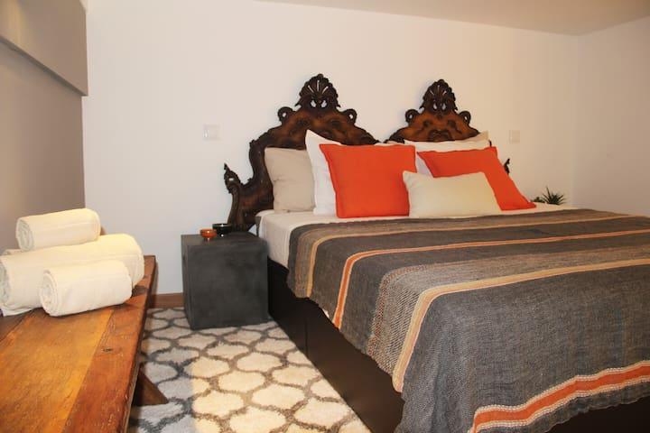 Mezzanine bedroom (Height 1.74m) with a Queen Bed
