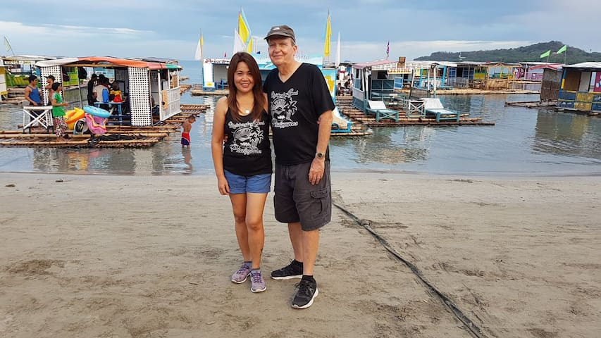 Your hosts at Matabungkay Beach, Angelita and Ken. We currently live in U.S., but our family in Philippines will do all they can to make your stay a wonderful experience.  If you have any questions for us, just message us and we will get right back!