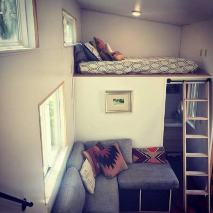 Guest loft with queen sized mattress above full bath and shower.