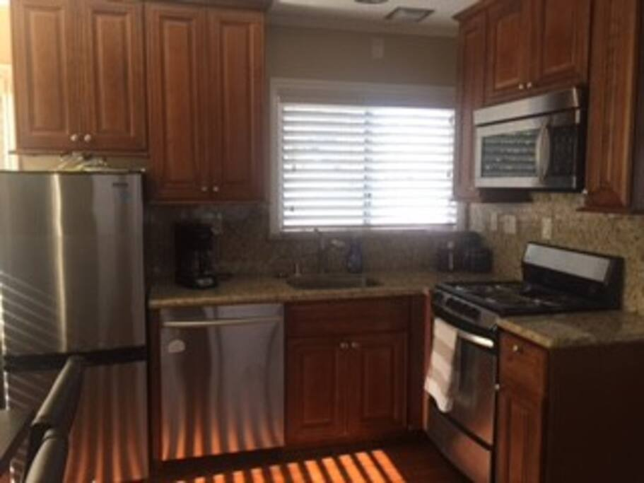 Brand new full kitchen with granite countertops.  Oven, stove, microwave, fridge and dishwasher.