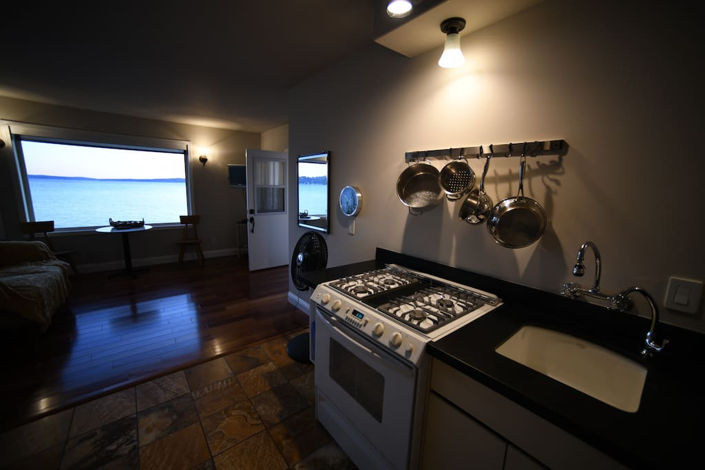 Full kitchen with gas range.  Coffee and hot water maker.  Refrigerator with ice maker.