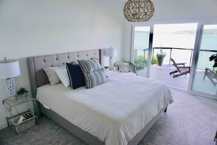 Master bedroom room with king size bed and double sliders to the large private deck!
