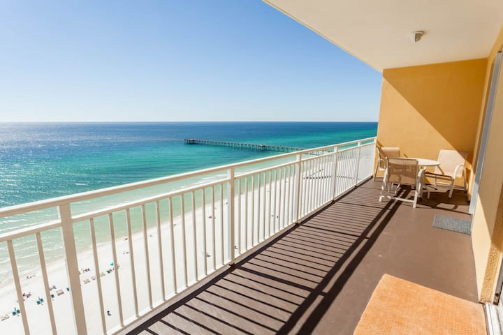 Sunny getaway at the beach w/ a furnished balcony, shared pool, & fitness room