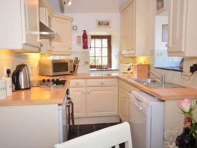 Kitchen with dishwasher, microwave, fan oven, ceramic hob and fridge