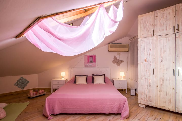 pink and cozy private room in a villa with a pool