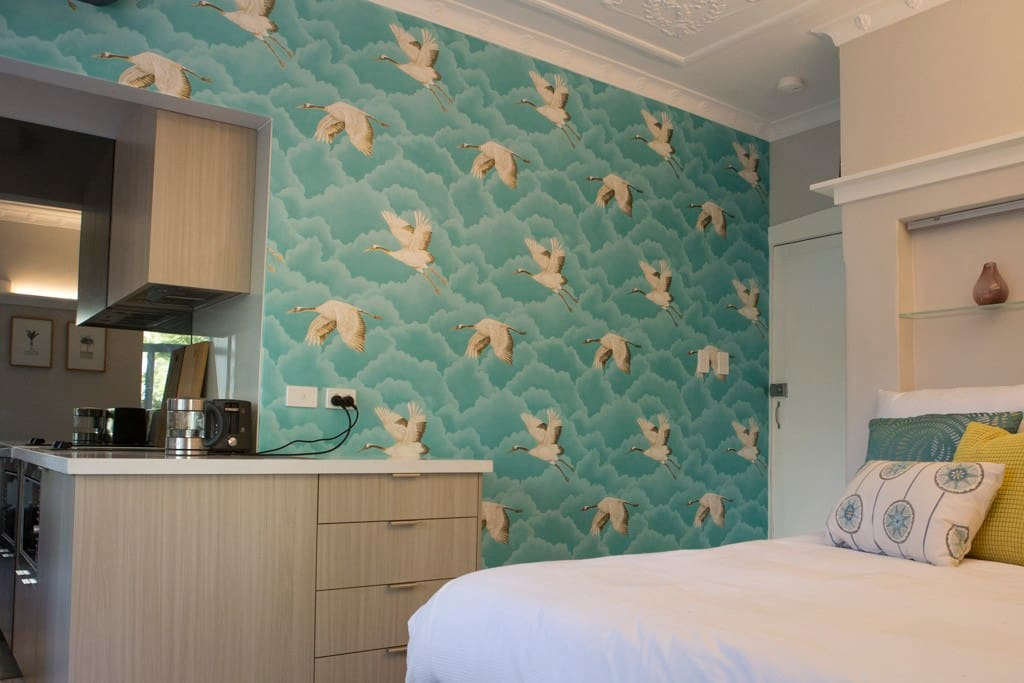 Delicious queen sized bed and decorative ceiling