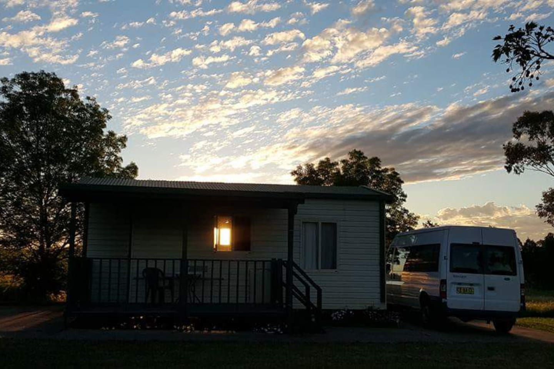 The sun setting behind cabin #4