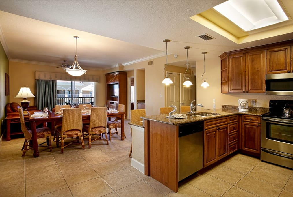 Family meals are easy with a fully equipped kitchen and spacious dining area.