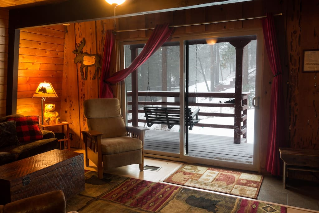 Open the living room curtains to enjoy the winter wonderland.