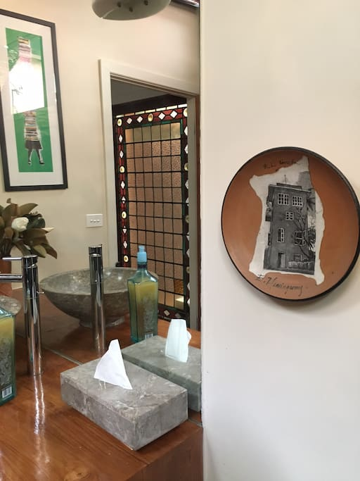 Our house is filled with beautiful things we have gathered on our travels. This is your bathroom. See the Hemingway treasure from Havana? Spot the street art from Buenos Aires?