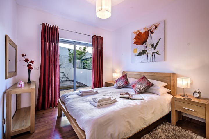 The master bedroom offers a great kingsize bed