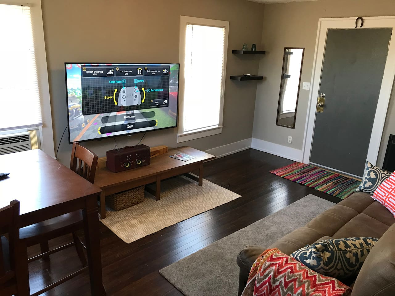 """Living room with 65"""" smart tv."""