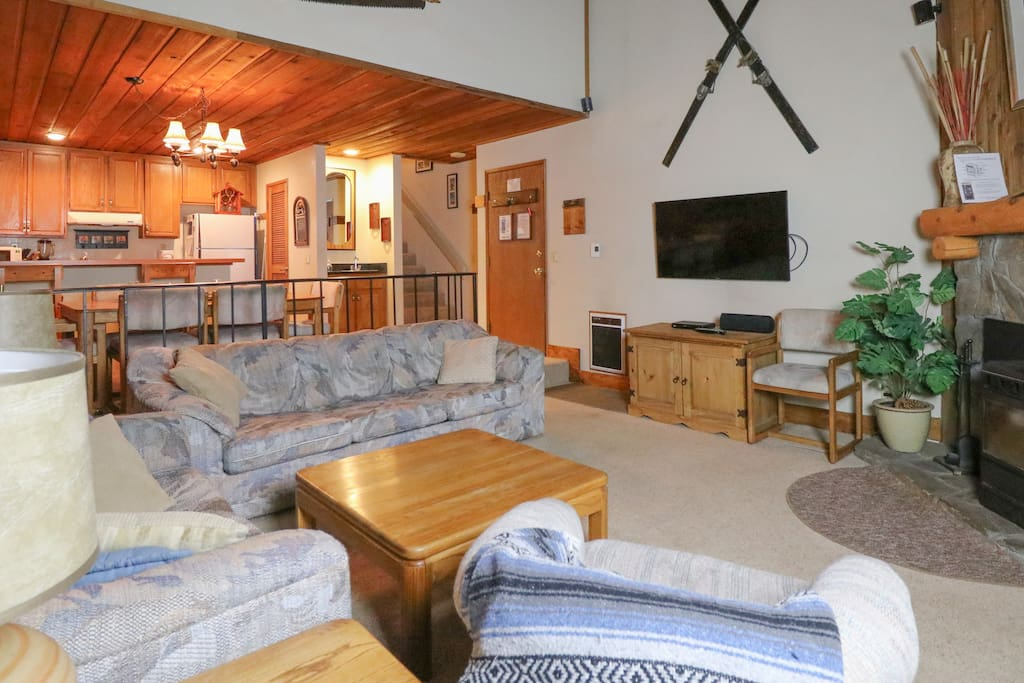 The main living area offers a comfy sleeper sofa and love seat.