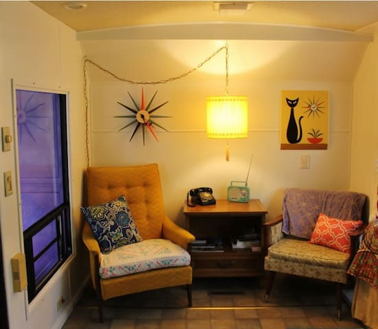 What's more fun?  Watching your kids try to figure out the rotary phone, or tune-in the radio?  The Happy Camper is glamper fun with a 60's vibe….all the eclectic décor will take you right back to a simpler time.