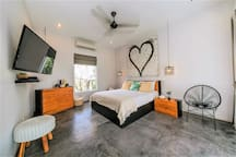 Queen sized bedroom with private ensuite on the second floor.  Leads out to undercover balcony overlooking pool and gardens