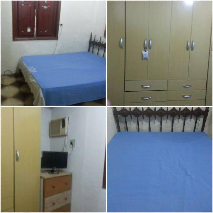 quarto com cama de casal,armário e tv