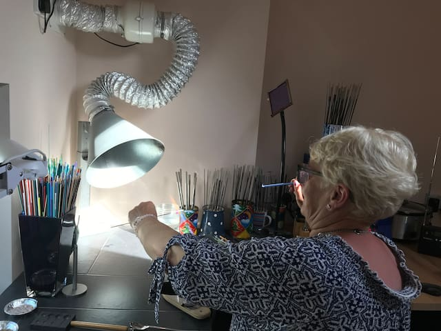 An Airbnb guest making beads